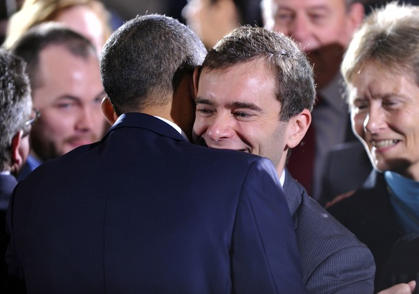 US President Barack Obama greets members