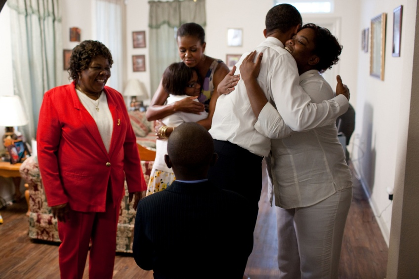 President Barack Obama and First Lady Michelle Obama greet members of Maude Smith's family at her home in New Orleans, La., Aug. 29, 2010. The President and First Lady were visiting New Orleans to mark the five-year anniversary of hurricane Katrina. (Official White House Photo by Pete Souza)