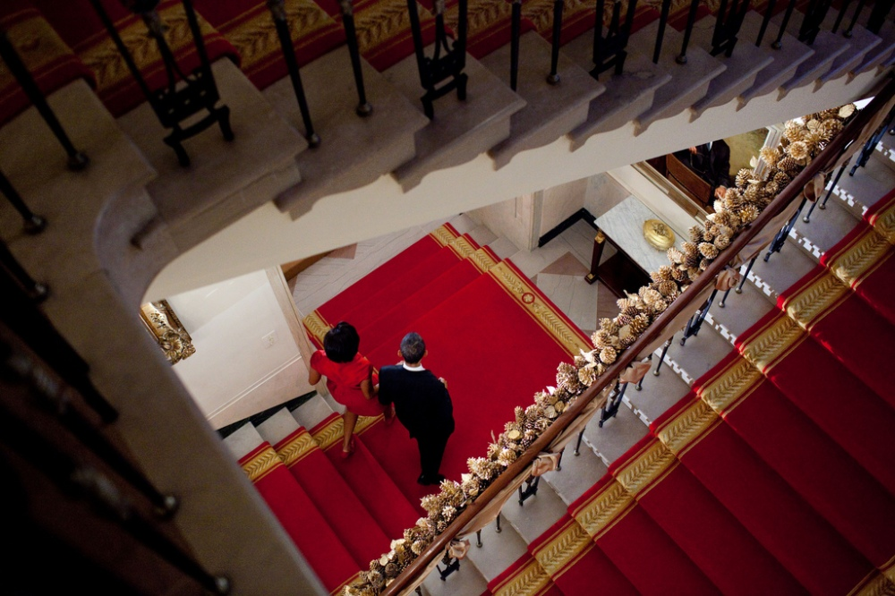 President Barack Obama and First Lady Michelle Obama descend the Grand Staircase as they make their way to a holiday reception on the State Floor of the White House, Dec. 10, 2010. (Official White House Photo by Pete Souza)