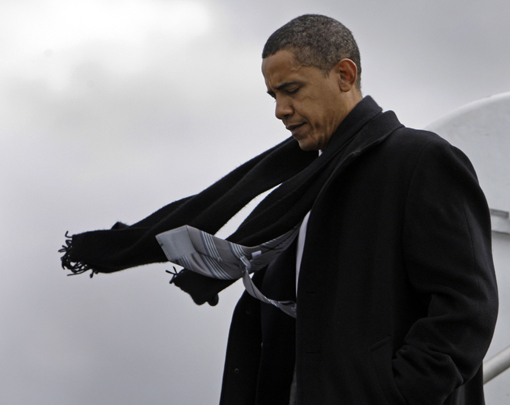 Democratic presidential candidate Sen. Barack Obama, D-Ill., steps off the plane in Weyers Cave, Va., as his scarf and tie blow in the wind Tuesday, Oct. 28, 2008.  (AP Photo/Alex Brandon)