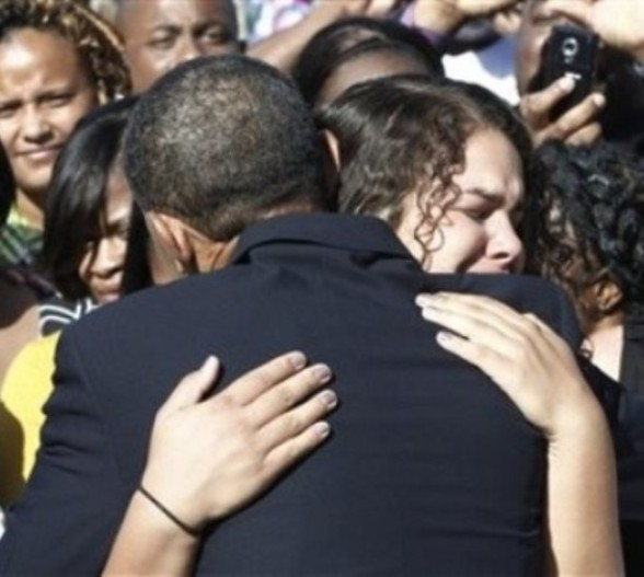 President Barack Obama hugs an unidentified woman as he greets family members of victims after speaking at the Pentagon Memorial, marking the ninth anniversary of the September 11 attacks, Saturday, Sept. 11, 2010. (AP Photo/Charles Dharapak)