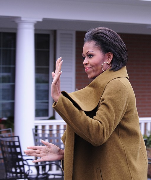 US First Lady Michelle Obama arrives for dedication ceremonies of the new Fisher Houses on the campus of Naval Support Activity in Bethesda, Maryland, on December 2, 2010. Fisher House helps 13,000 families and has made more than three million days of lodging available to family members since it originated in 1990. Fisher House also administers ?Scholarships for Military Children,? a program for the sons and daughters of service members. AFP PHOTO/Karen BLEIER (Photo credit should read KAREN BLEIER/AFP/Getty Images)