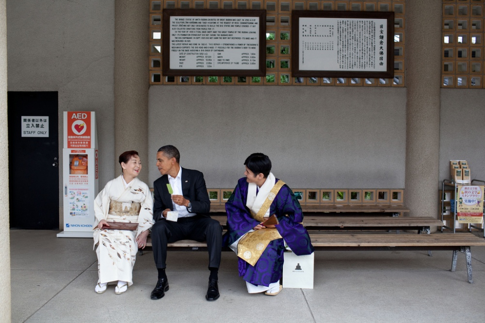 President Barack Obama eats green tea ice cream during his visit to the Great Buddha of Kamakura at the Kotoku-in Temple in Kamakura, Japan, Nov. 14, 2010. (Official White House Photo by Pete Souza)