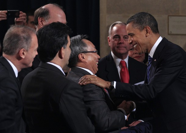 U.S. President Barack Obama greets guests after addressing the U.S. Chamber of Commerce in Washington