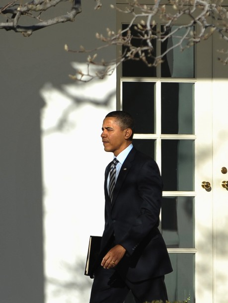 US President Barack Obama makes his way to the Oval Office to speak to National Security Advisor Tom Donilon on the situation in Egypt February 10, 2011 before his departure on Marine One at the White House in Washington, DC. Obama was headed to Marquette, Michigan to see a demonstration of a WiMax network at Northern Michigan University and to speak on the on the National Wireless Initiative. AFP PHOTO/Mandel NGAN (Photo credit should read MANDEL NGAN/AFP/Getty Images)