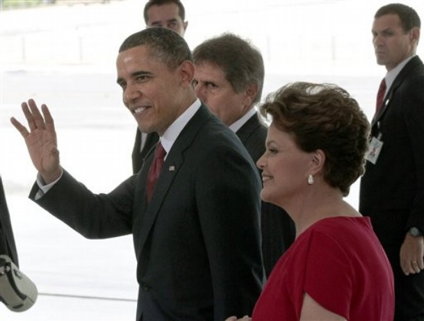 U.S. President Barack Obama, left, walks with Brazilian President Dilma Vana Roussseff, right, during the arrival at the Palacio do Planalto in Brasilia, Brazil, Saturday, March 19, 2011. (AP Photo/Pablo Martinez Monsivais)