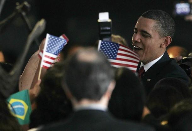 U.S. President Barack Obama is surrounded by Brazilian primary school kids in Brasilia
