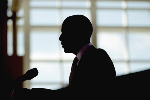President Barack Obama is silhouetted during his speech at Kenmore Middle School in Arlington, Va., Monday, March, 14, 2011. (AP Photo)