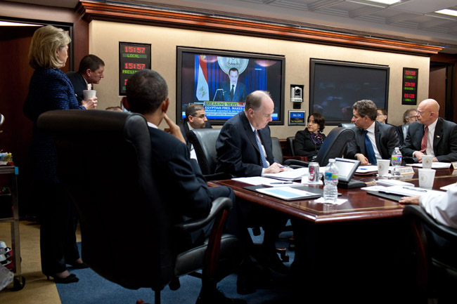 President Barack Obama watches as Egyptian President Hosni Mubarak delivers a televised statement, during a meeting in the Situation Room of the White House, Feb. 1, 2011. Joining the President are Secretary of State Hillary Rodham Clinton, National Security Advisor Tom Donilon, Treasury Secretary Timothy Geithner, Director of National Intelligence James Clapper, and other members of his national security team. (Official White House Photo by Pete Souza)